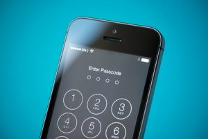 close-up shot of brand new apple iphone 5s showing four digits passcode security system to prevent unauthorized access.