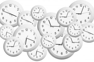 several clocks in different sizes and times in a background